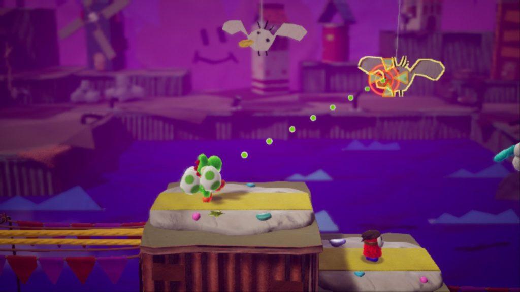 Yoshi's Crafted World 4 Colpire oggetti nello sfondo